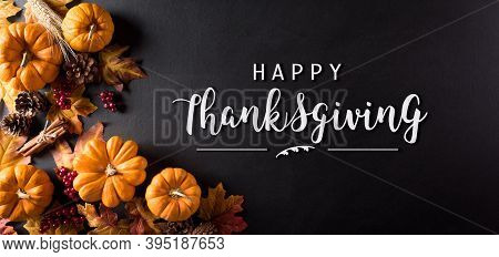 Thanksgiving Background Decoration From Dry Leaves,red Berries And Pumpkin On Blackboard Background.