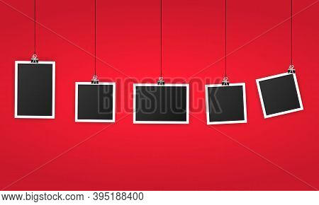 An Empty Photo Frame Set Hanging On A Clip. Black Blank Space For Text Or Photo. Realistic Photo Ico