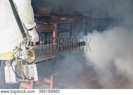 A Man Use Fumigation Mosquitoes Machine For Kill Mosquito Carrier Of Zika Virus And Dengue Fever Pre