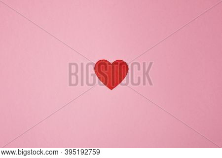 Overhead Shot Of A Red Heart On A Pink Background. Background For Valentine's Day. Horizontal Photog