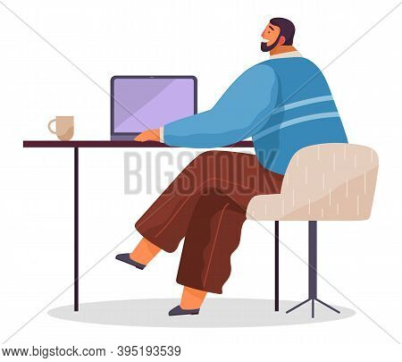 Office Worker At The Table With A Laptop. Smiling Man Office Worker Enterpreneur Performs Work On A