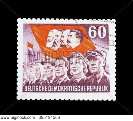 Cancelled Postage Stamp Printed By East Germany, That Shows Workers And Red Flag With Portraits Of K