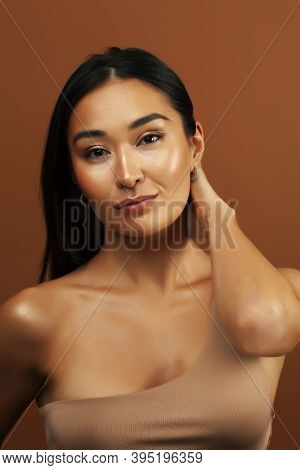 Young Pretty Asian Woman Cheerful Smiling Posing On Warm Brown Background, Lifestyle People Concept