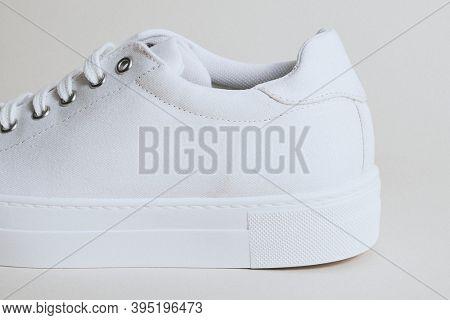 Woman's white canvas sneaker mockup on white