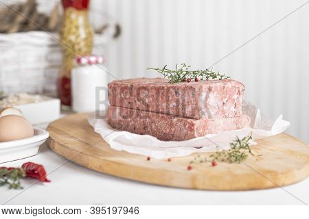 Semi-finished Meat, Seasoned On A Wooden Background.