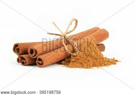 Cinnamon Sticks And Cinnamon Powder Isolated On White Background, Healthy Spice, (cinnamomum)