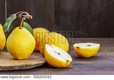 Fresh Ripe Yellow Williams Pear Fruits On Wooden Background, Healthy Organic Fruit Concept, Close Up