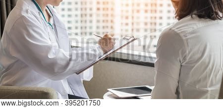 Menopause Woman Patient Risk With Ovarian Or Cervical Cancer Consulting With Doctor Who Diagnostic E