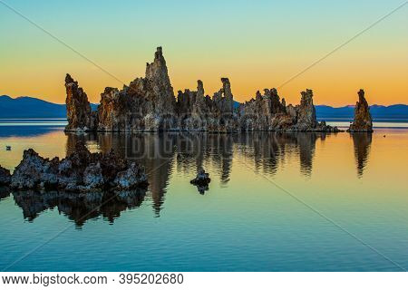 Magnificent reflections of tuff outliers in lake water. Mono Lake is a salt lake in California. Lime-tuff towers of bizarre shapes rise from the bottom of the lake.