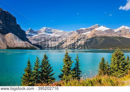 Glacial lake with azure clear water. Lake Bow. Alberta, Rocky Mountains, Canada. Icefield Parkway is a popular tourist road that runs along the shore of the lake. Cold sunny autumn day