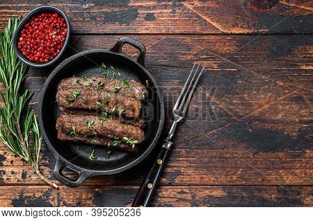 Grilled Mince Meat Sausages In A Pan. Dark Wooden Background. Top View. Copy Space