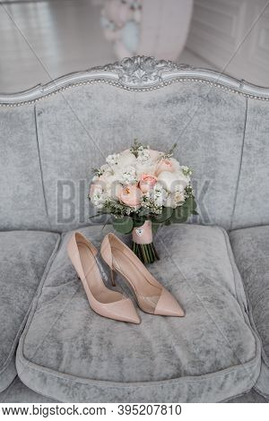 Beige Bridal Wedding Shoes And Bridal Bouquet Roses