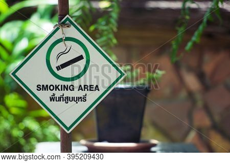 Designated Smoking Area Sign On A Board In Front Of The Restaurant Entrance. Designated Smoking Area
