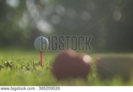 Golf Ball On Green Grass,golf Sport Is Balance Of Yin Yang.copy Space Left And Right For Adding Text