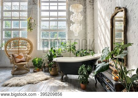 Comfortable Bathroom With Interior Design In Boho Chic Style, Bathtub, Vintage Commode With Mirror,