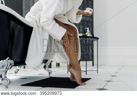 Concept Of Beauty Procedure. Cropped View Of Afro American Woman In Bathrobe Spending Morning In Bat