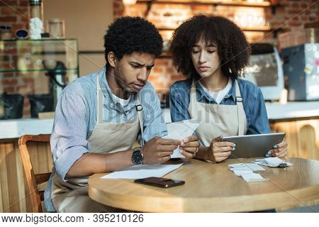 Problems In Small Business During Covid-19 Lockdown. Sad Millennial African American Couple Owners I