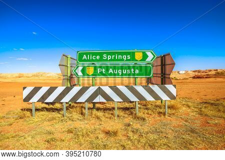 Directions Road Sign For Alice Springs And Pt Augusta In Coober Pedy Town In Australia. Opal Mining