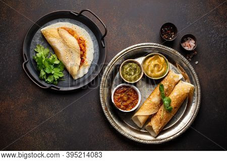 Different Types Of Traditional Indian Rice Pancakes Dosa. Dosa Filled With Vegetables Sambar And Pla