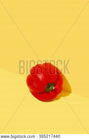 Red Fresh Bell Pepper On Bold Yellow Background. Minimal Trendy Composition. Healthy Organic Vegan F