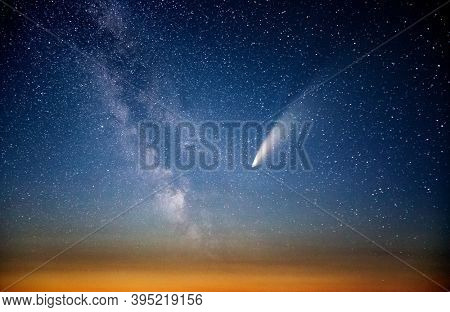 Wonderful view of starry sky and C/2020 F3 (NEOWISE) comet with light tail. Location place of Ukraine, Europe. Long exposure shot, astrophotography. Dramatic wallpaper. Discover the beauty of earth.