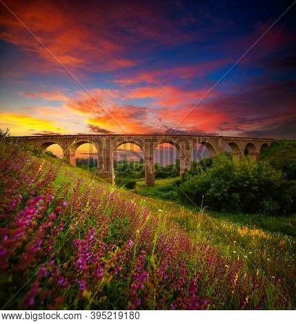Fantastic view to beautiful old railway viaduct. Location village Plebanivka, Ukraine, Europe. Scenic image of most popular travel destination. Famous historical place. Discover the beauty of earth.