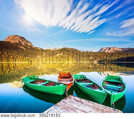 Impressive view of Black lake. Location place National park Durmitor, village Zabljak, Montenegro, Balkans, Europe. Vibrant photo wallpaper. Exotic place in the world. Discover the beauty of earth.