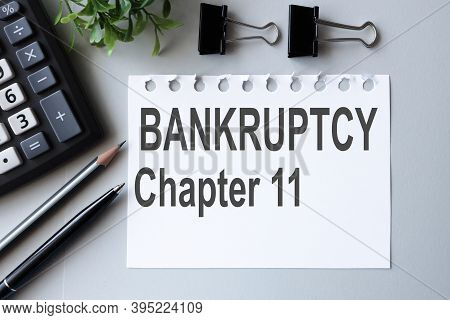 Bankruptcy Chapter 11, Text On White Paper Over Gray Background