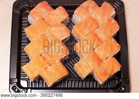 Philadelphia Classic. Salmon, Philadelphia Cheese, Cucumber, Avocado, Tobiko. Japanese Sushi. Top Vi