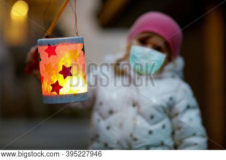 Toddler Girl Holding Selfmade Lantern For St. Martin Procession. Child Wear Medical Mask. Children A