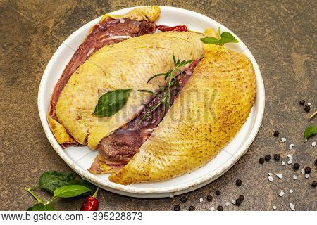 Raw Duck Breasts With Fresh Greens And Fragrant Spices