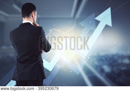 Successful Young Businessman Is Thinking About Business Development On The Background Of An Up Arrow