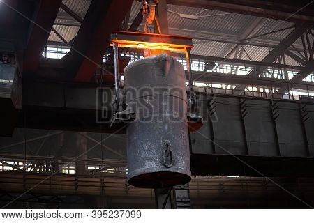 Iron Casting At The Foundry. Overhead Crane With Ladle With Molten Metal At Metallurgical Factory