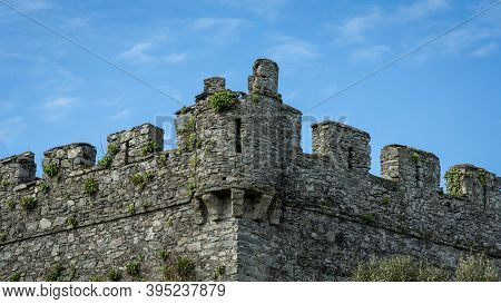 Symmetric Turret And Battlements On An Ancient Castle In Ireland