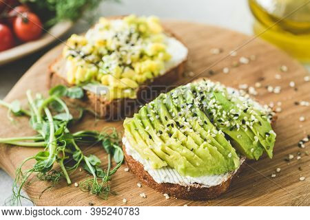 Avocado Toast With Sesame Seeds On Wooden Board. Healthy Appetizer, Snack Or Breakfast With Avocado