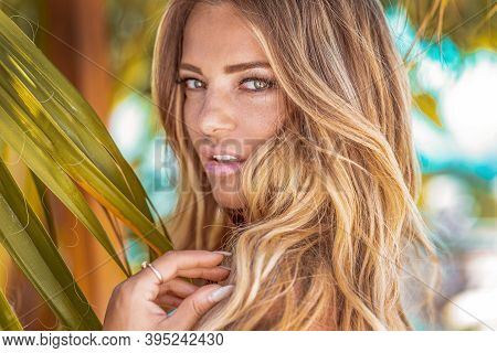 Sensual Portrait Of Beautiful Blonde Woman Looking Away.
