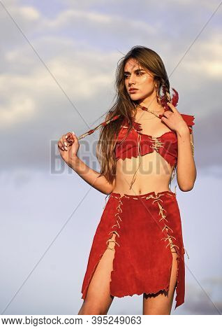 Fashion Model Posing In Boho Style Clothes In Rays Of Sunrise. Wild Woman Look At Sunset. Indie Styl