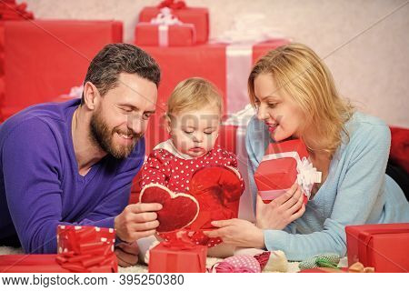 Couple In Love And Baby Daughter. Valentines Day Concept. Together On Valentines Day. Lovely Family