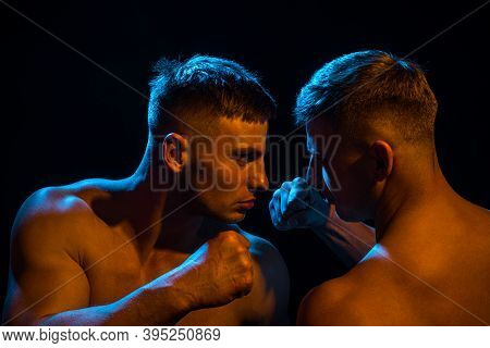 Two Aggressive Men. Violent Concept. Guys Fight. Angry Male. Strong And Power Mans Hand With Muscles