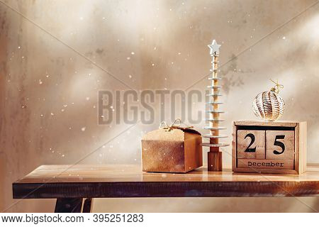Cute Decorative Little Christmas Tree With Gift, Ornament And Wooden Block Calendar.