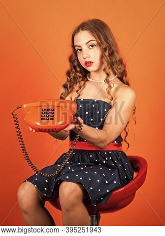 Communication Concept. Shopping Online. Retro Girl Speak Phone. Outdated Device. Kid Talking Vintage