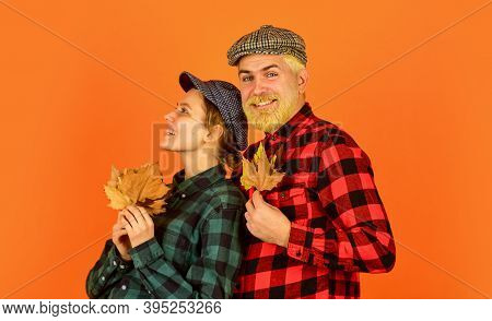 Carefree Time Together. Retro Couple Autumn Leaves. Man And Woman Hold Maple Leaf. Farmer Countrysid