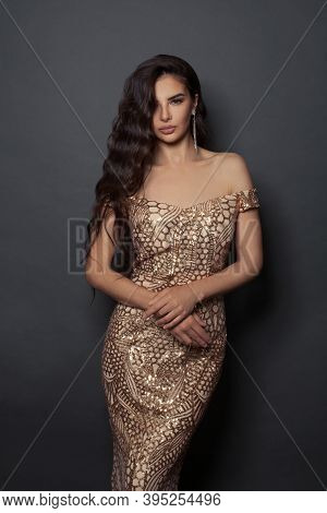 Stylish Woman With Long Perfect Hair And Makeup On Black Background