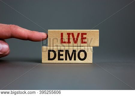 Concept Words 'live Demo' On Wooden Blocks On A Beautiful Grey Background. Male Hand. Copy Space. Bu