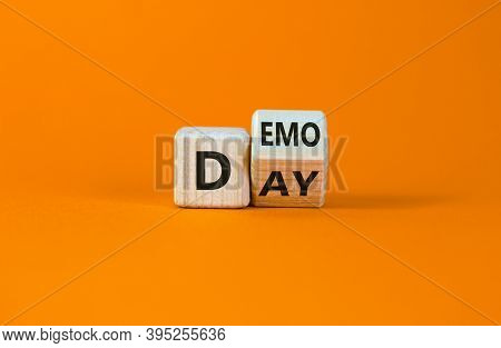 Fliped Wooden Cubes With Concept Words 'demo Day' On A Beautiful Orange Background. Copy Space. Busi