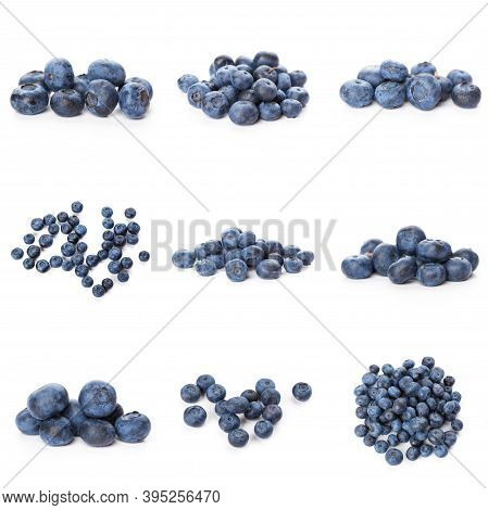 Group Of Fresh Blueberries Isolated On White Background . Full Depth Of Field