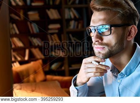 Serious Focused Businessman Wearing Computer Glasses Looking At Pc Screen With Computer Reflection U