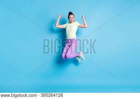 Full Length Body Size Photo Of Pretty Girl Jumping High Laughing Showing Strong Arms Smiling Isolate