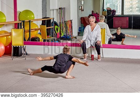 A Young Man Dances At A Ballet School. Sports Lifestyle And Body Flexibility.
