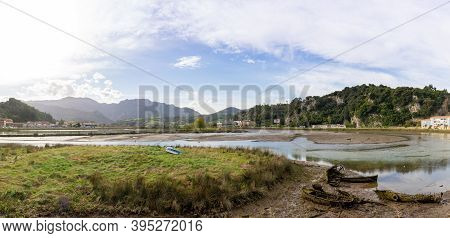A View Of The Estuary Of The Sella River In Asturias At Low Tide With Old Row Boat Wrecks